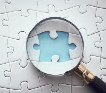 Image of a magnifying glass looking at a missing puzzle piece