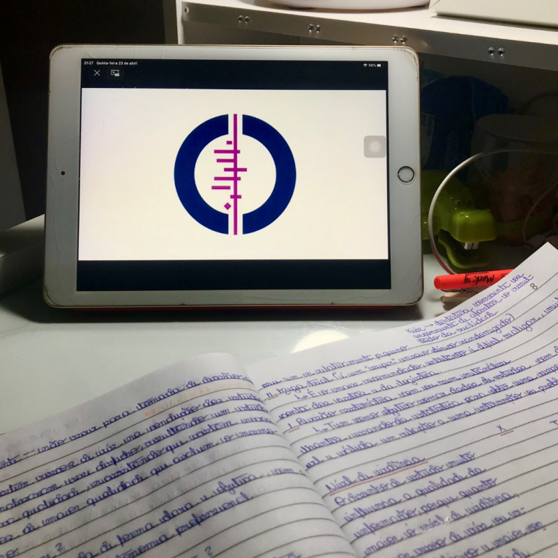 Image of a table with a tablet with the Cochrane logo and a notebook with writing in it