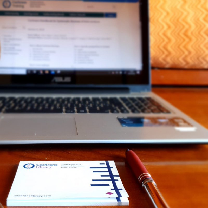 picture of a computer, pen, and note pad with Cochrane logo