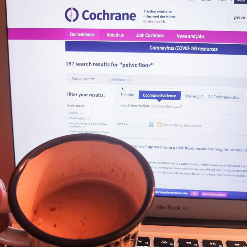 Picture of a computer screen with Cochrane Library on it, and a mug of coffee